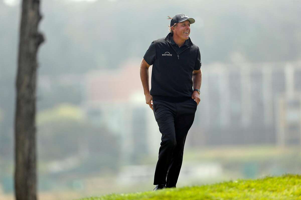 Phil Mickelson smiles as he approaches 17th tee during 3rd round of PGA Championship at TPC Harding Park in San Francisco, Calif., on Saturday, August 8, 2020.