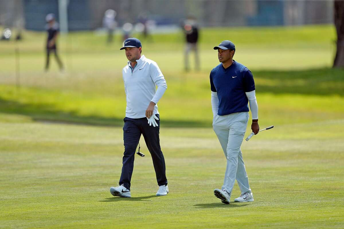 Keith Mitchell and Tiger Woods walk up 9th fairway during 3rd round of PGA Championship at TPC Harding Park in San Francisco, Calif., on Saturday, August 8, 2020.