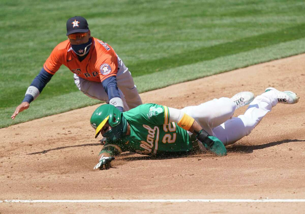 OAKLAND, CALIFORNIA - AUGUST 08: Ramon Laureano #22 of the Oakland Athletics gets caught in a rundown and tagged out by Yuli Gurriel #10 of the Houston Astros in the bottom of the third inning at RingCentral Coliseum on August 08, 2020 in Oakland, California.