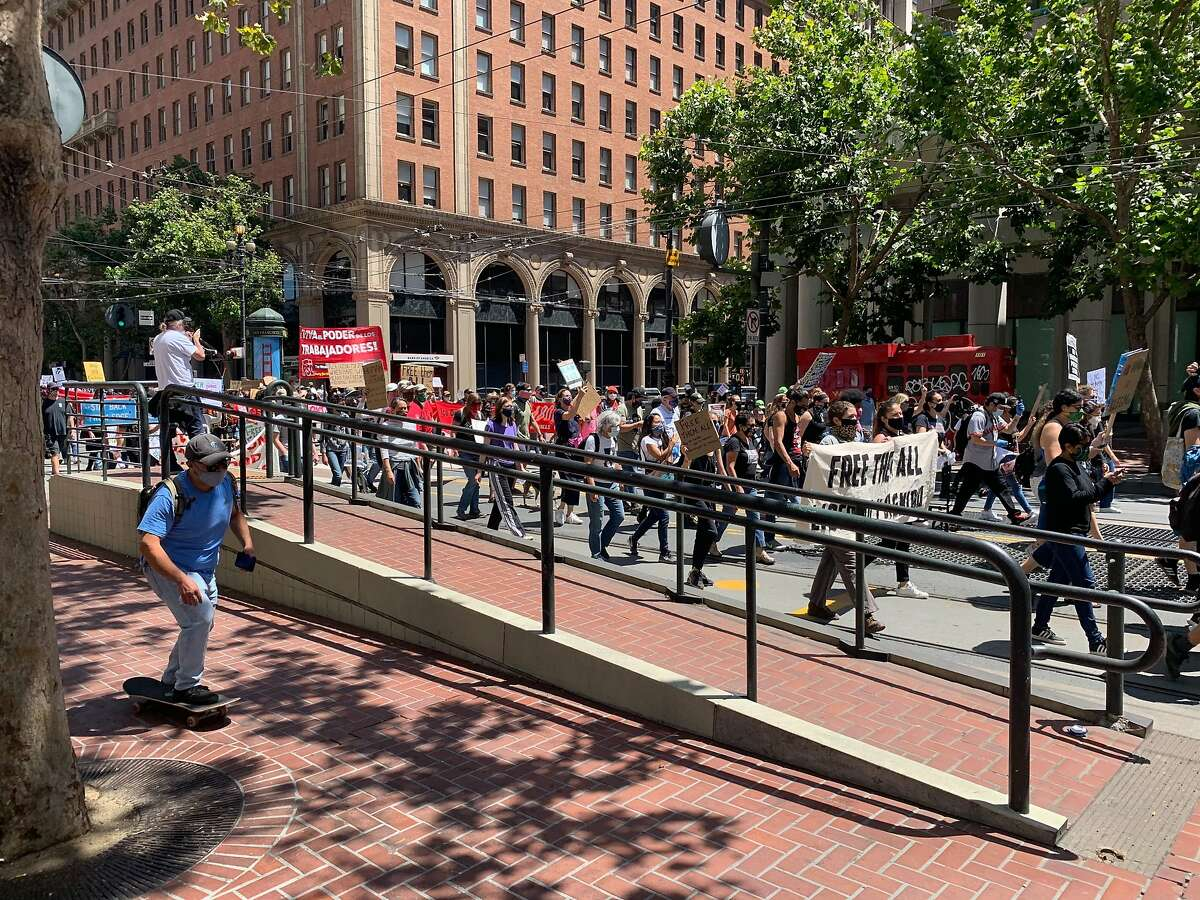 Protesters against U.S. Immigration and Customs Enforcement march down Market Street Saturday.