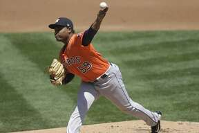 Houston Astros pitcher Framber Valdez works against the Oakland Athletics in the first inning of a baseball game Saturday, Aug. 8, 2020, in Oakland, Calif. (AP Photo/Ben Margot)