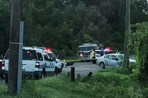 A serious crash involving a motorcycle on Candlewood Lake Road in Brookfield, Conn., on Saturday, Aug. 8, 2020.