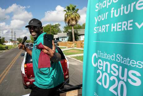 J.C. Williams, the Director of Community Engagement for City Councilwoman Jada Andrews-Sullivan, District 2, does a Facebook Live video as he and other volunteers and Census Bureau personnel drive a small float and car caravan through the Eastside in San Antonio, Texas, U.S., in order to raise awareness about the 2020 Census on Saturday, August, 8, 2020. The Census data must be collected by September 30 this year.