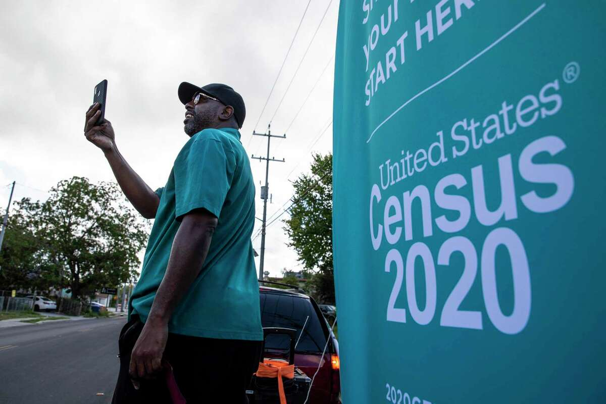 J.C. Williams with the office of District 2 City Councilwoman Jada Andrews-Sullivan does a Facebook Live broadcast in August from a celebration promoting the 2020 census in the city's East Side.