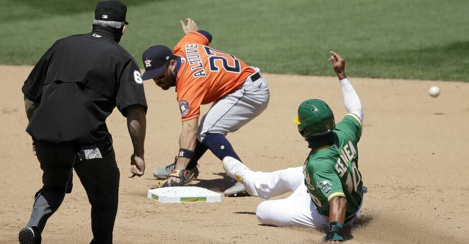 Oakland Athletics' Marcus Semien, right, slides in to steal second base as Houston Astros' Jose Altuve (27) misses the ball in the sixth inning of a baseball game Saturday, Aug. 8, 2020, in Oakland, Calif. (AP Photo/Ben Margot) Photo: Ben Margot/Associated Press / Copyright 2020 The Associated Press. All rights reserved