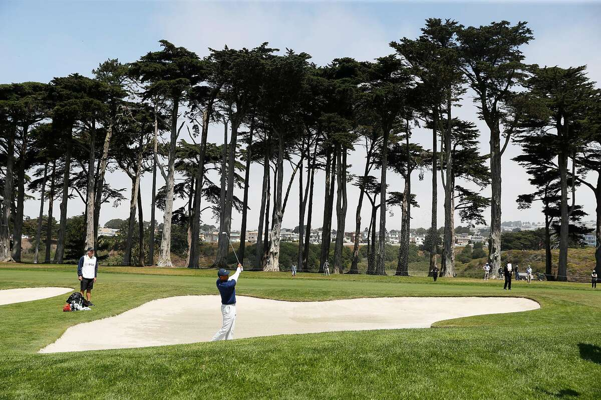Tiger Woods hits out of a fairway bunker on 10th hole during 3rd round of PGA Championship at TPC Harding Park in San Francisco, Calif., on Saturday, August 8, 2020.