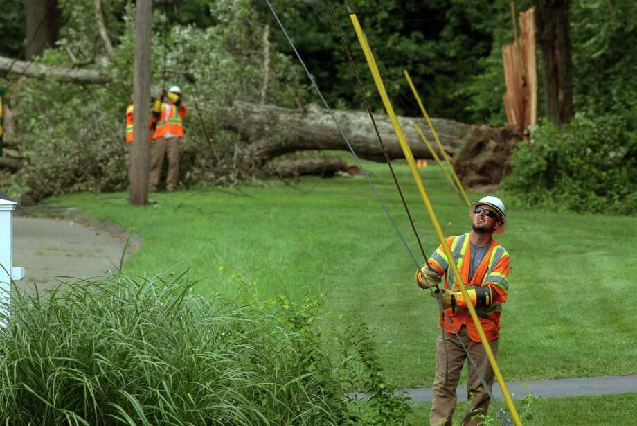 Crews working to restore power on Friday Aug. 7, 2020. Photo: Christian Abraham / Hearst Connecticut Media / Connecticut Post