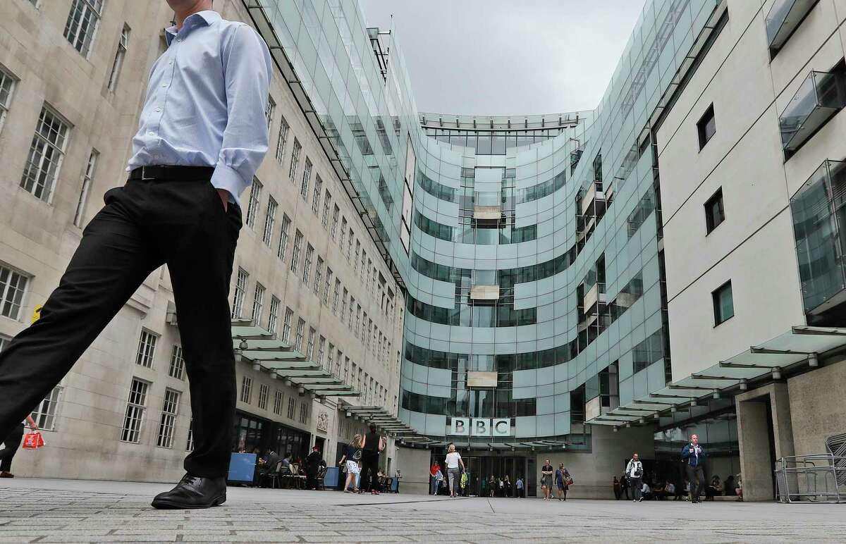 FILE - This Wednesday, July 19, 2017 file photo shows the main entrance to the headquarters of the publicly funded BBC in London. British radio host Sideman quit the BBC on Saturday Aug. 8, 2020, over the corporationa€™s decision to include a racial slur in a news report about a racist attack. (AP Photo/Frank Augstein, File)