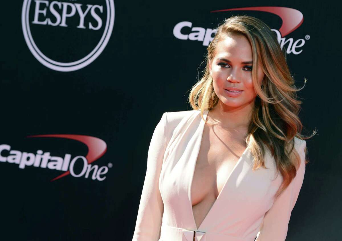 Model Chrissy Teigen arrives at the ESPY Awards at the Nokia Theatre on Wednesday, July 16, 2014, in Los Angeles. (Photo by Jordan Strauss/Invision/AP) ORG XMIT: CABS124