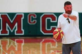 Chris Beard, head coach for the Texas Tech men's basketball team, motions for a cut as he and his teammates run a play from the days as members of the 1991 McCullough High School varsity basketball team gather for a reunion at McCullough Junior High School, Saturday, Aug. 8, 2020, in The Woodlands.