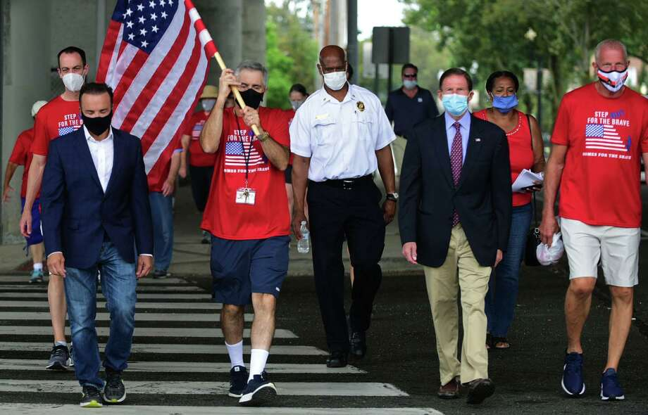 Supporters for Homes For the Brave including Bridgeport Mayor Joe Ganim, Homes of the Brave CEO Vincent Santilli, Deputy Fire Chief Lance Edward and US Senator Richard Blumenthal and Shelton Mayor Mark Lauretti participate in the 6th Annual Step OUT for the Brave 40,000 Step Virtual Challenge, a fundraiser for homeless veterans Saturday August 8, 2020, in Bridgeport, Conn. The supporters joined 600 people across the nation participating in the walk. Photo: Erik Trautmann / Hearst Connecticut Media / Norwalk Hour