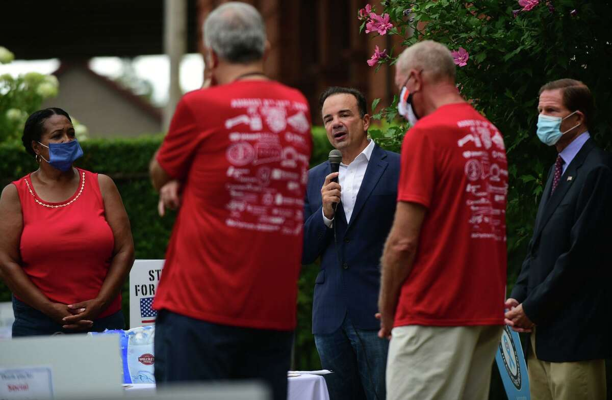 Supporters for Homes For the Brave including Bridgeport Mayor Joe Ganim speak before the 6th Annual Step OUT for the Brave, a fundraiser for homeless veterans Saturday August 8, 2020, in Bridgeport, Conn. The supporters joined 600 people across the nation participating in the walk.