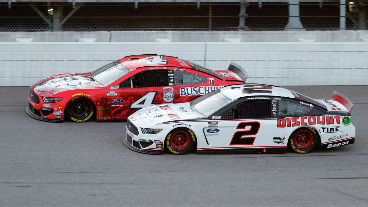 Kevin Harvick (4) competes with Brad Keselowski (2) during a NASCAR Cup Series auto race at Michigan International Speedway in Brooklyn, Mich., Saturday, Aug. 8, 2020. (AP Photo/Paul Sancya)