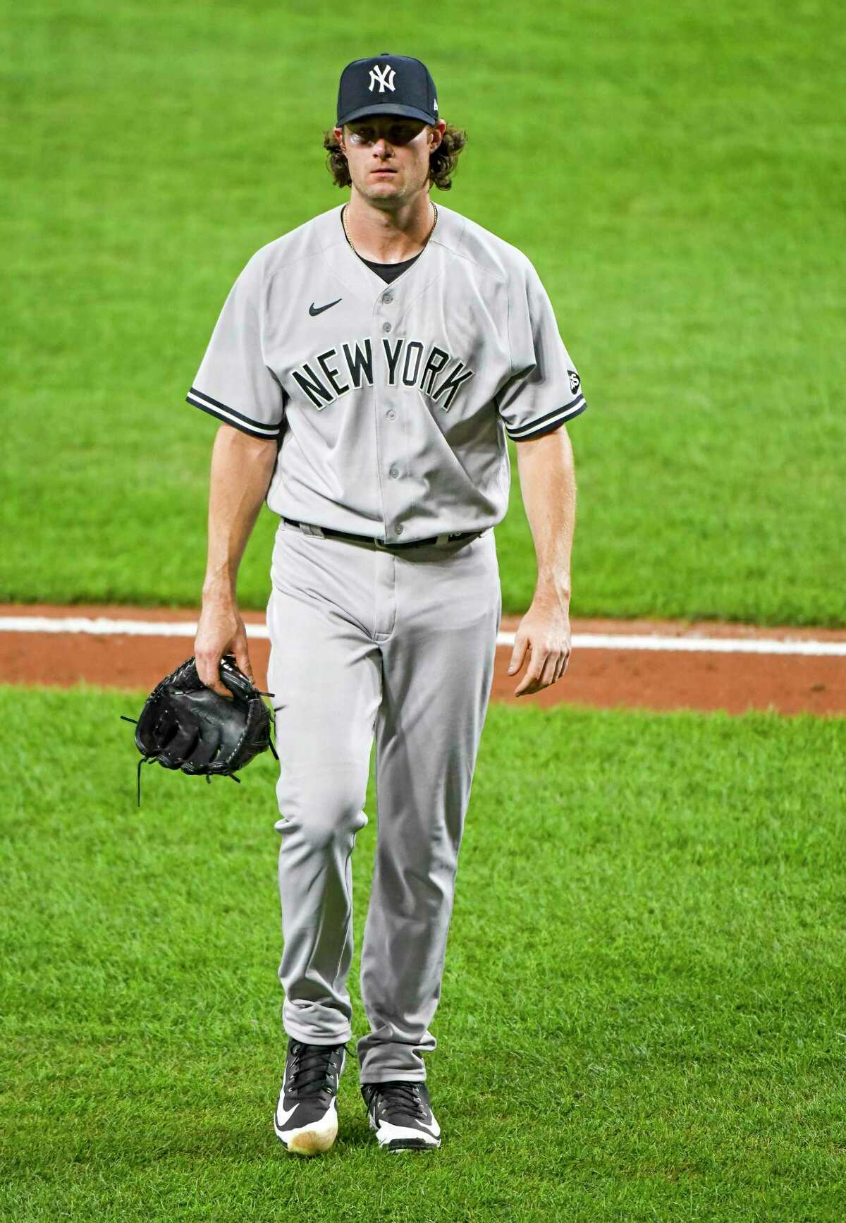BALTIMORE, MD - JULY 29: New York Yankees starting pitcher Gerrit Cole (45) leaves the game against the Baltimore Orioles in the seventh inning on July 29, 2020, at Orioles Park at Camden Yards, in Baltimore, MD. (Photo by Mark Goldman/Icon Sportswire via Getty Images)