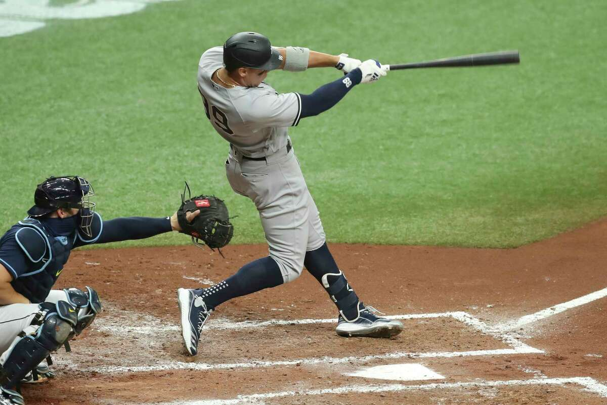 ST. PETERSBURG, FL - AUGUST 08: New York Yankees right fielder Aaron Judge (99) singles in the 3rd inning of the MLB game between the New York Yankees and Tampa Bay Rays on August 08, 2020 at Tropicana Field in St. Petersburg, FL.(Photo by Mark LoMoglio/Icon Sportswire via Getty Images)