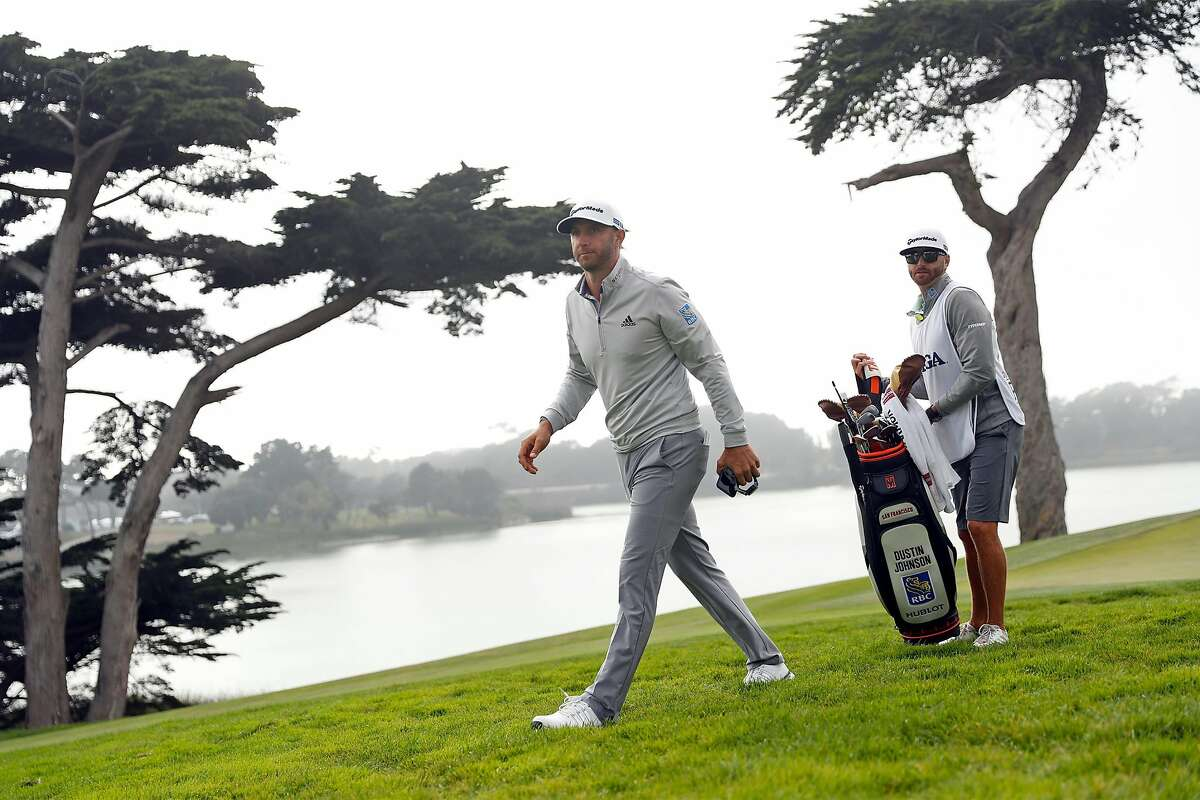 Dustin Johnson walks off the 18th green during 3rd round of PGA Championship at TPC Harding Park in San Francisco, Calif., on Saturday, August 8, 2020. Johnson shot a 65 (-5) and has the tournament lead at -9.