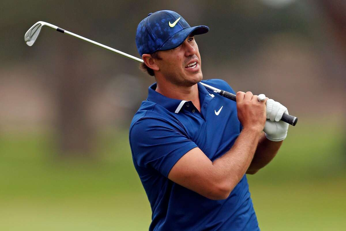 Brooks Koepka watches his approach shot to 7th green during 3rd round of PGA Championship at TPC Harding Park in San Francisco, Calif., on Saturday, August 8, 2020.