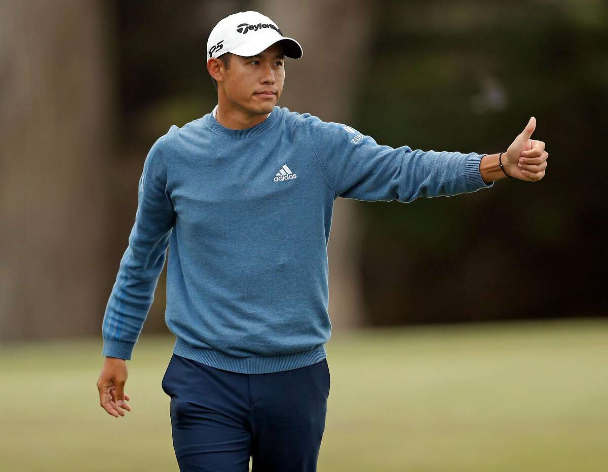 Collin Morikawa gives a thumbs up to playing partner Adam Scott after finishing with a 65 (-5) and -7 for the tournament during 3rd round of PGA Championship at TPC Harding Park in San Francisco, Calif., on Saturday, August 8, 2020.