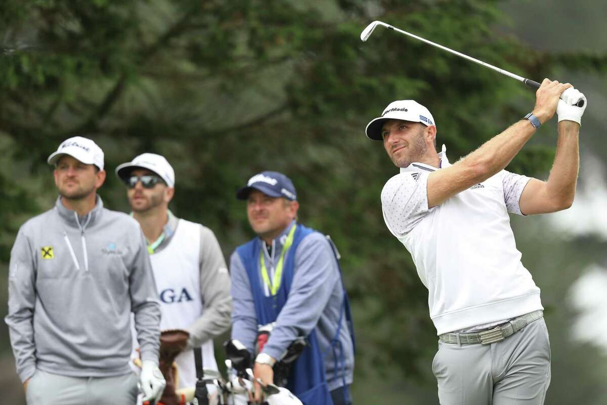 SAN FRANCISCO, CALIFORNIA - AUGUST 08: Dustin Johnson of the United States plays a shot from the third tee as Bernd Wiesberger of Austria and caddies look on during the third round of the 2020 PGA Championship at TPC Harding Park on August 08, 2020 in San Francisco, California. (Photo by Jamie Squire/Getty Images)