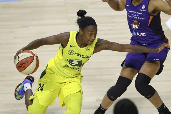 Seattle Storm's Jewell Loyd drives past the Phoenix Mercury defense during the second half of a WNBA basketball game Saturday, Aug. 8, 2020, in Bradenton, Fla. (AP Photo/Mike Carlson)