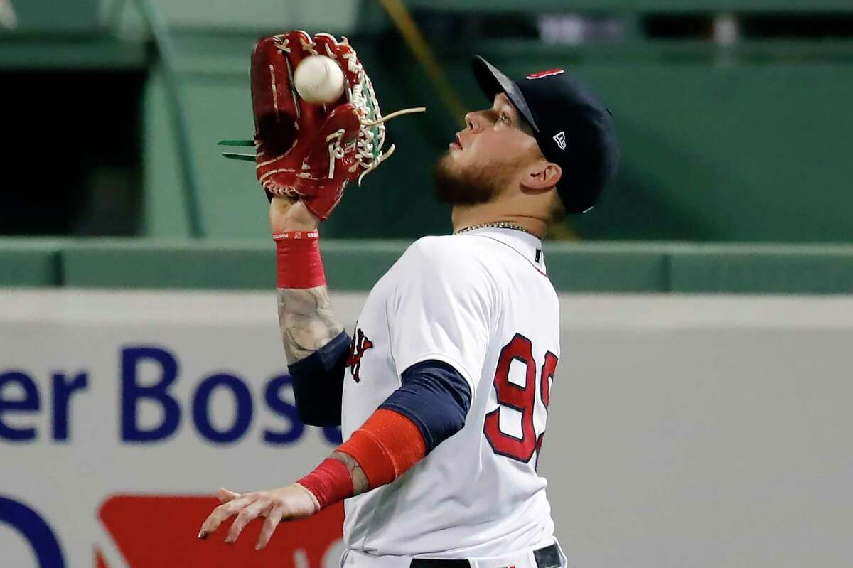 Boston Red Sox's Alex Verdugo makes the catch on the line out by Toronto Blue Jays' Bo Bichette during the third inning of a baseball game, Saturday, Aug. 8, 2020, in Boston. (AP Photo/Michael Dwyer)