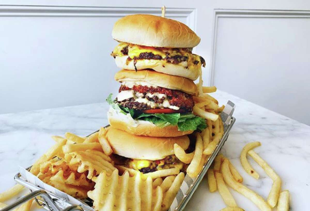A stack of burgers from pop-up Smish Smash, located inside Oakland's Cookiebar Creamery.