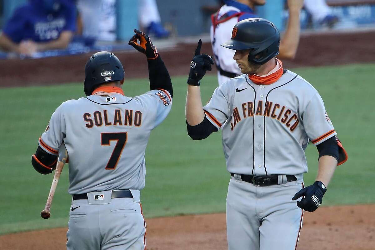 Austin Slater #13 of the San Francisco Giants celebrates his home run against the Los Angeles Dodgers with Donovan Solano #7 during the third inning at Dodger Stadium on August 08, 2020 in Los Angeles, California.