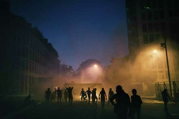 Protesters clashes with security forces in central Beirut during a demonstration against the government.