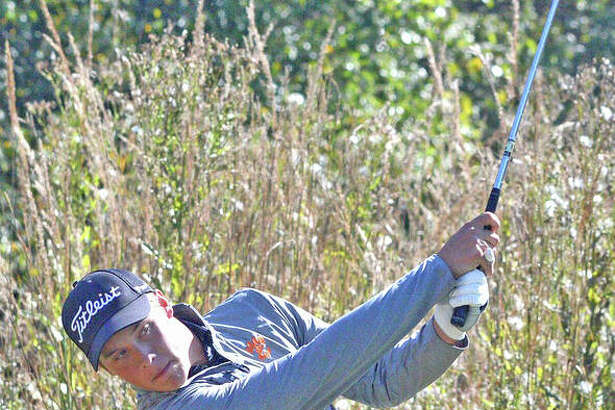Edwardsville's Taylor Janson watches his shot during a tournament last season for the Tigers.