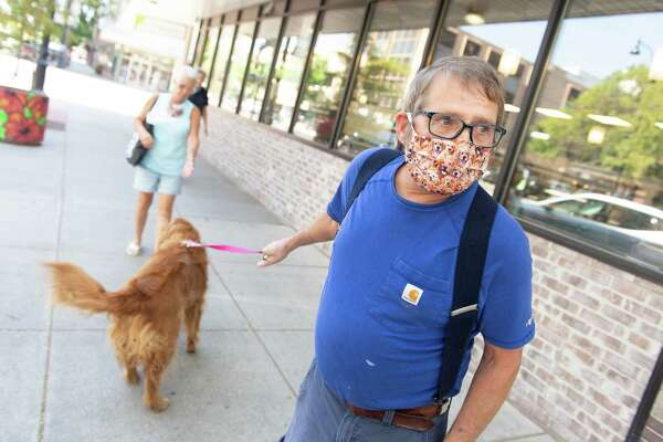Retired postmaster Keith Dordrum, walking his dog in Great Falls, Mont., says he approves of how Gov. Steve Bullock has handled the coronavirus.