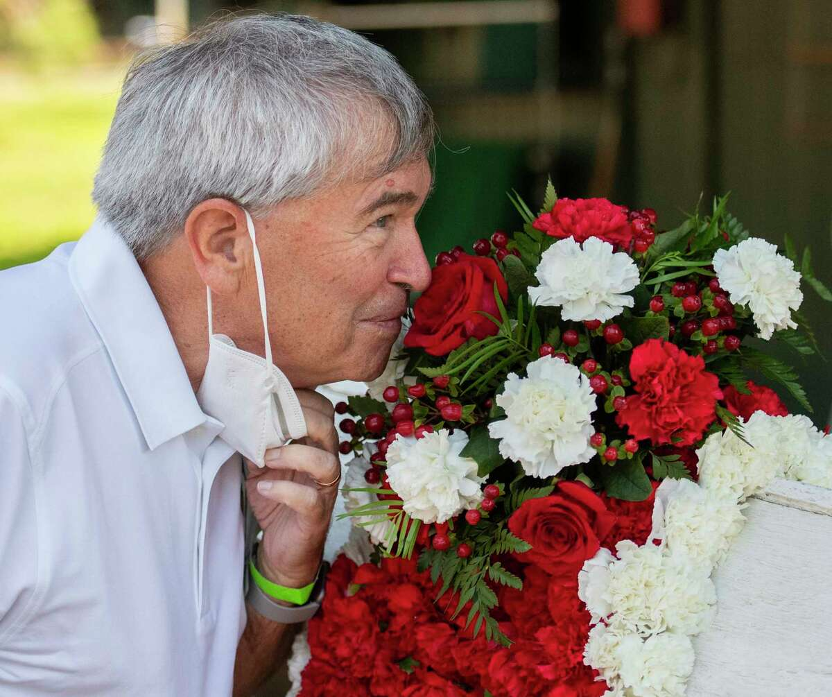 Sackatoga Stables managing partner and owner of Tiz the Law, Jack Knowlton smells a rose on the Travers Stakes winner?•s blanket in the barn area at the Saratoga Race Course Sunday Aug.9, 2020 in Saratoga Springs, N.Y. Perhaps with thoughts of the Tiz the Law?•s next start which will be in the Kentucky Derby September 5th. Photo by Skip Dickstein/Special to the Times Union