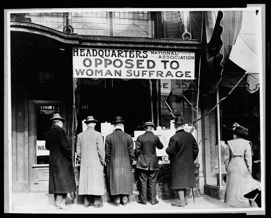 Men look at material posted in the window of the National Anti-Suffrage Association headquarters. Photo: Harris & Ewing/Library Of Congress / Harris & Ewing/Library of Congress