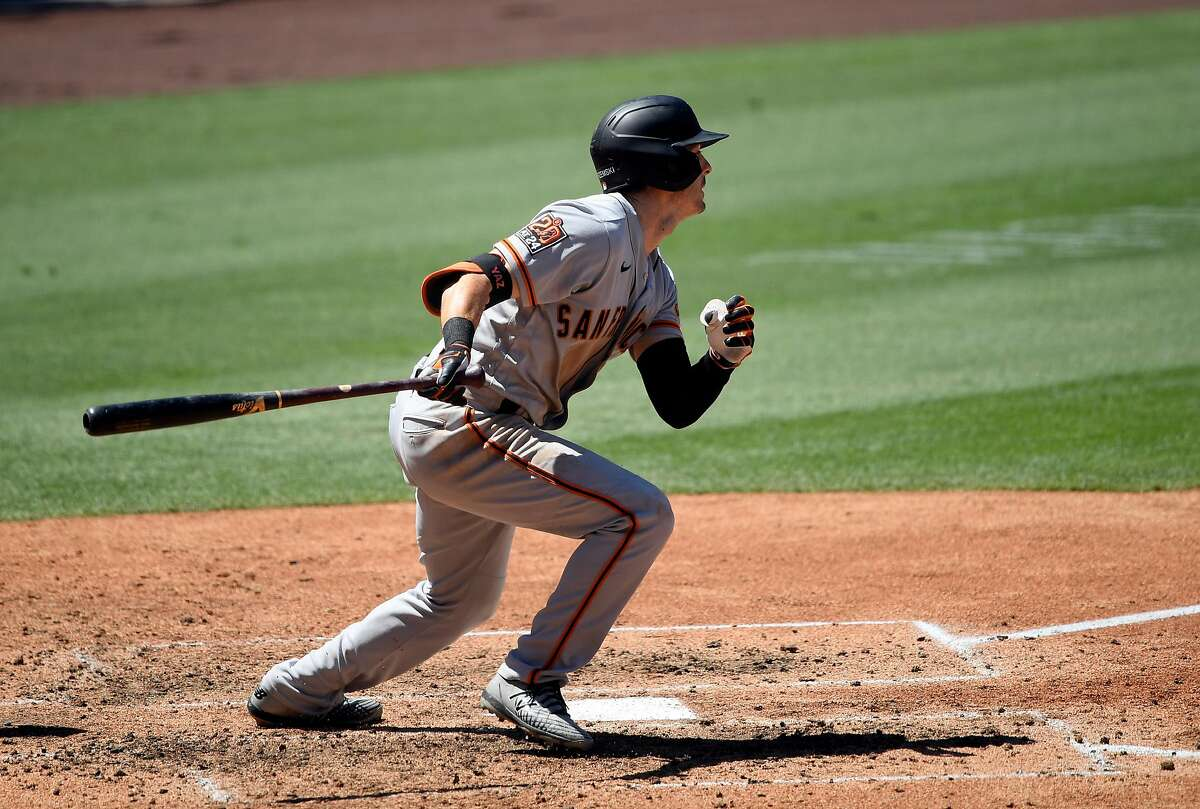 LOS ANGELES, CA - AUGUST 09: Mike Yastrzemski #5 of the San Francisco Giants hits a two run double against Los Angeles Dodgers during the fifth inning at Dodger Stadium on August 9, 2020 in Los Angeles, California. (Photo by Kevork Djansezian/Getty Images)