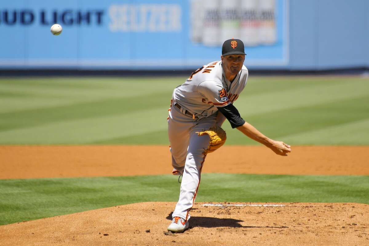 San Francisco Giants starting pitcher Kevin Gausman throws to the plate during the first inning of a baseball game against the Los Angeles Dodgers, Sunday, Aug. 9, 2020, in Los Angeles. (AP Photo/Mark J. Terrill)
