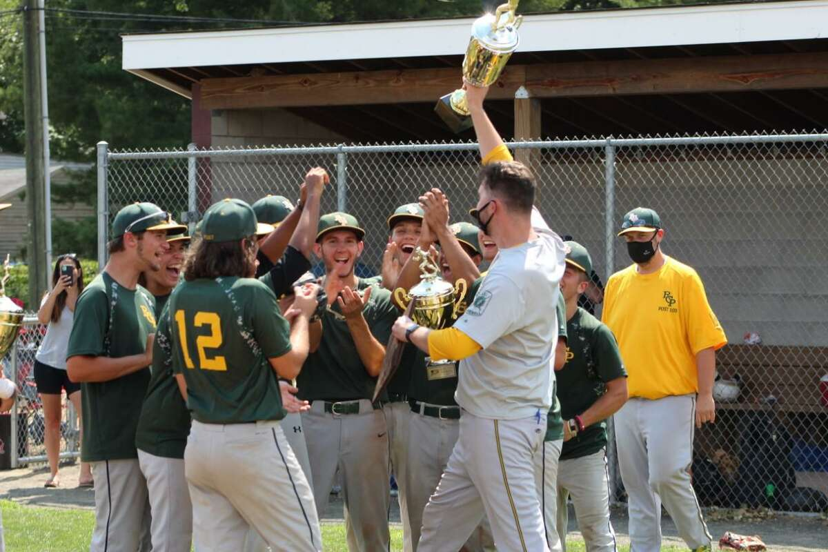 Rocky Hill/Cromwell/Portland coach Paul Francis hoists the championship trophy after the team won the Connecticut Elite Baseball Association U19 title on Sunday.