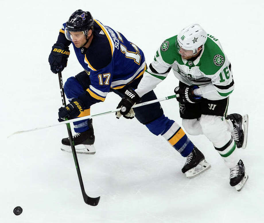 The Blues' Jaden Schwartz (17) and the Stars' Joe Pavelski battle for the puck during the first period Sunday in Edmonton, Alberta. Photo: Associated Press