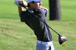 Marquette Catholic's Aidan O'Keefe watches his drive during last season's Marquette Class 1A Regional at Spencer T. Olin Golf Course. O'Keefe begins his sophomore season with the Explorers at the season's first practice Monday.