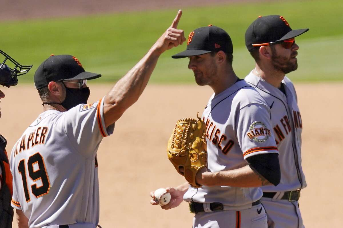 San Francisco Giants starting pitcher Kevin Gausman, center, is taken out of the game by Manager Gabe Kapler, left, during the seventh inning of a baseball game against the Los Angeles Dodgers Sunday, Aug. 9, 2020, in Los Angeles. (AP Photo/Mark J. Terrill)