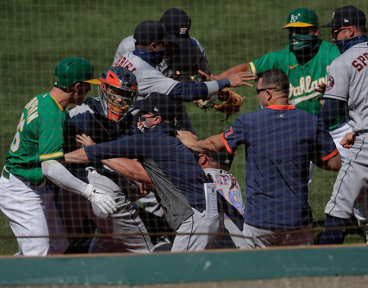 The Oakland Athletics and Houston Astros got into a benches clearing brawl after Ramon Laureano (22) was hit by a pitch from pitcher Humberto Castellanos (72) in the seventh inning at the Coliseum in Oakland, Calif., on Sunday, August 9, 2020.