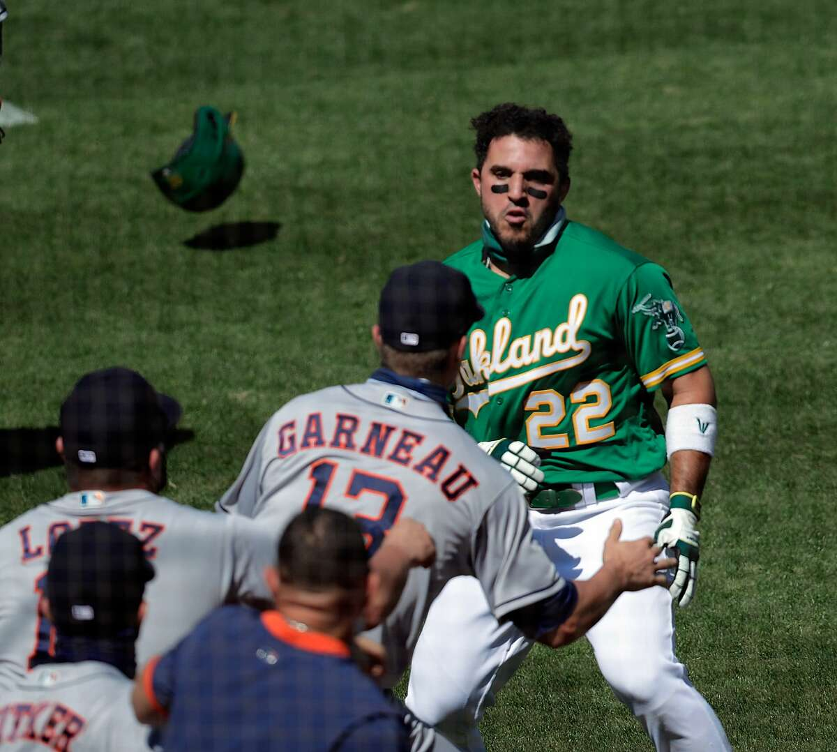 Ramon Laureano (22) charges the Astros dugout from first base leading into a benches clearing brawl after Laureano (22) was hit by a pitch from pitcher Humberto Castellanos (72) in the seventh inning at the Coliseum in Oakland, Calif., on Sunday, August 9, 2020.