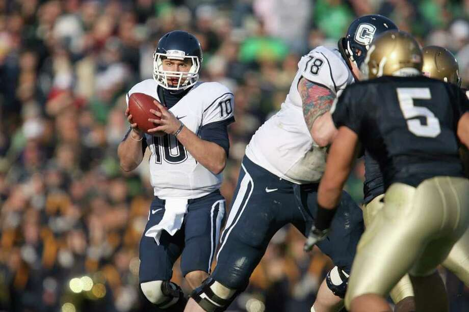 SOUTH BEND, IN - NOVEMBER 21:  Quarterback Zach Frazer #10 of the Univeristy of Connecticut Huskies looks to pass the ball during the game against the Notre Dame Fighting Irish at Notre Dame Stadium on November 21, 2009 in South Bend, Indiana. (Photo by Jonathan Daniel/Getty Images) Photo: Jonathan Daniel, Getty Images / 2009 Getty Images