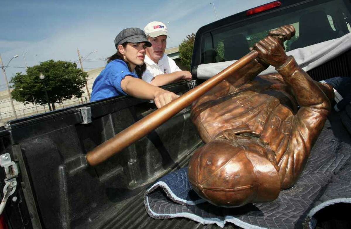 Sculptor Susan Clinard and Bridgeport Deputy Director of Planning and Economic Development Ed Lavernoich get a close look at a sculpture of Baseball Hall of Fame member James O'Rourke. Clinard sculpted the statue and was on hand to guide the installation in front of the Ballpark at Harbor Yard in Bridgeport, Conn. on Saturday August 21, 2010.