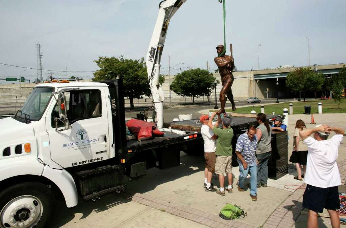 The statue of 1945 Baseball Hall of Fame member James O'Rourke is lowered into position on a pedestal outside of the Ballpark at Harbor Yard in Bridgeport, Conn. on Saturday August 21, 2010.