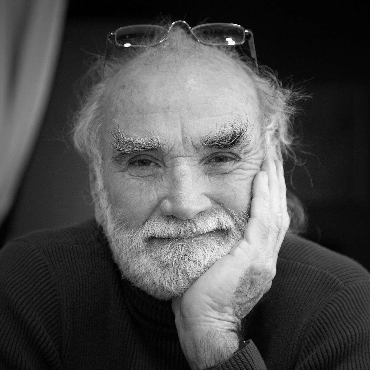 A portrait of award-winning photojournalist and activist Matthew Herron.