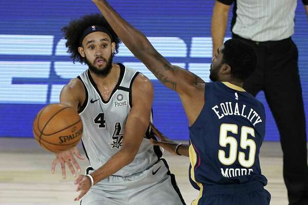 Derrick White, being guarded by the Pelicans' E'Twaun Moore, left the arena in Lake Buena Vista, Fla., early in the third quarter after suffering what the Spurs called a left knee contusion.