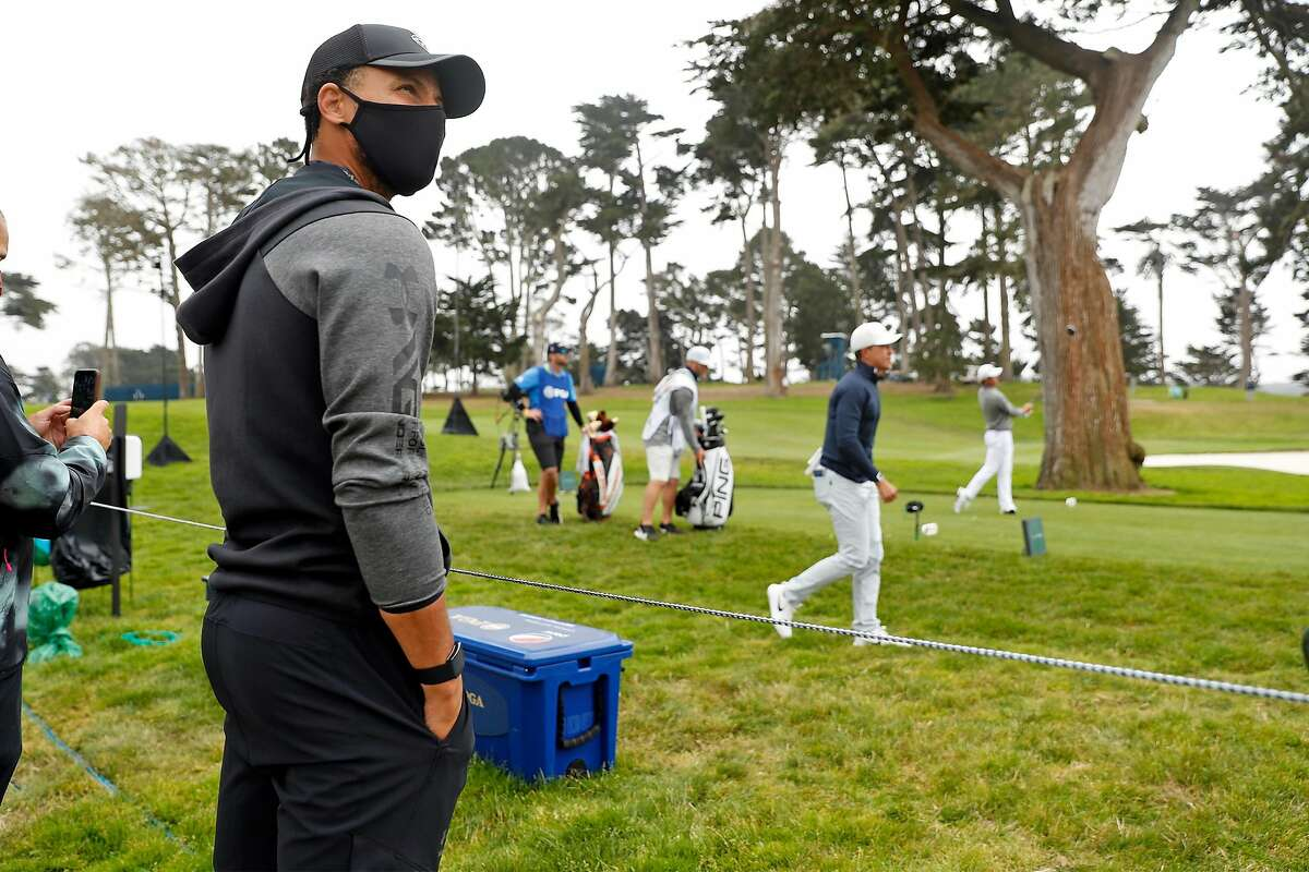 Stephen Curry watches a drive by eventual winner Collin Morikawa on the 9th hole during the final round of the PGA Championship at Harding Park on Aug. 9, 2020.