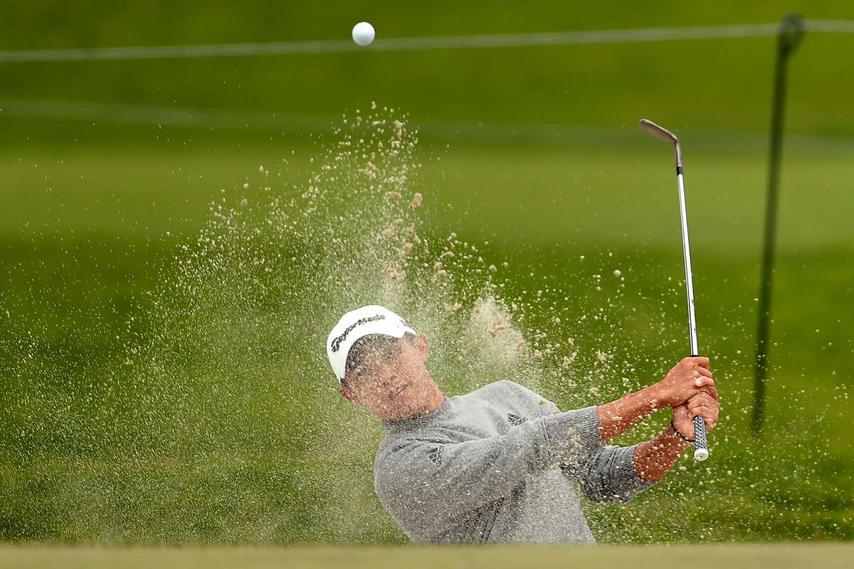 Collin Morikawa hits from the 1st hole bunker during final round of PGA Championship at TPC Harding Park in San Francisco, Calif., on Sunday, August 9, 2020.