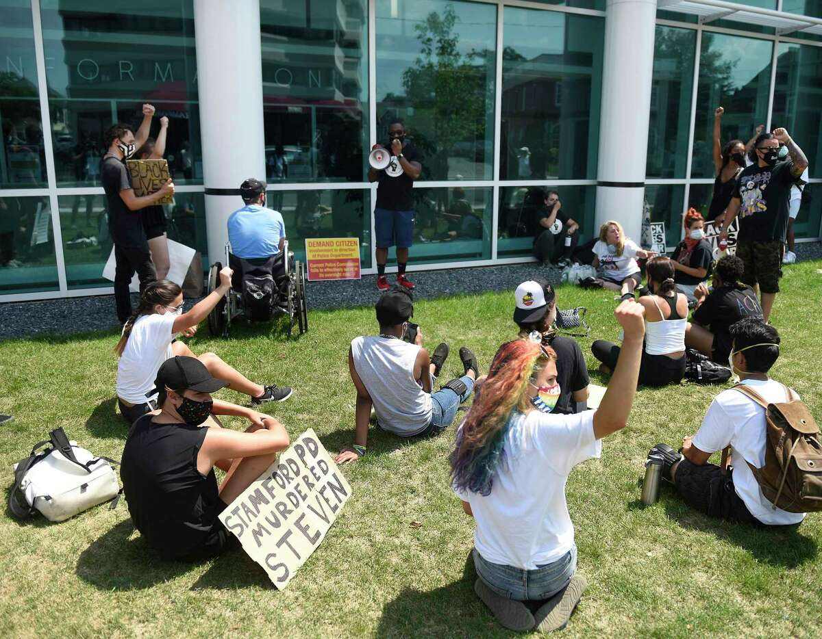 Protesters gather outside the Stamford Police Department to demand justice for Steven Barrier on Sunday. Assembled by the Justice for Brunch group, the protesters demanded officers be held accountable for the death of Barrier, who died while in Stamford Police custody in October 2019.