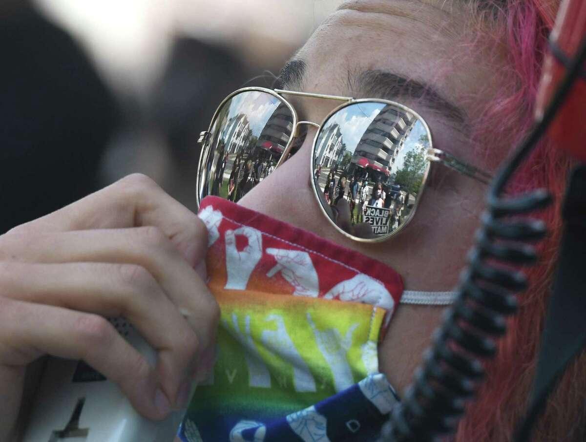 """Stamford native Ceren """"Ren"""" Citak speaks during the rally"""