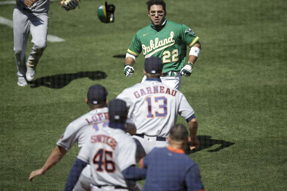 Oakland Athletics' Ramon Laureano (22) charges the Houston Astros' dugout after being hit by a pitch thrown by Humberto Castellanos during the seventh inning of a baseball game Sunday, Aug. 9, 2020, in Oakland, Calif. Photo: Ben Margot / Associated Press